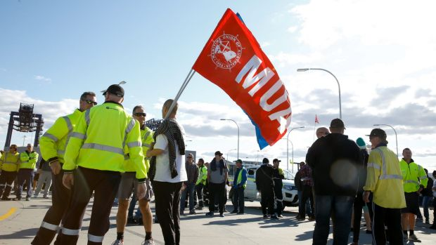 Hutchison Ports Australia's workers gather at Port Botany, Sydney, after being sacked by email overnight.