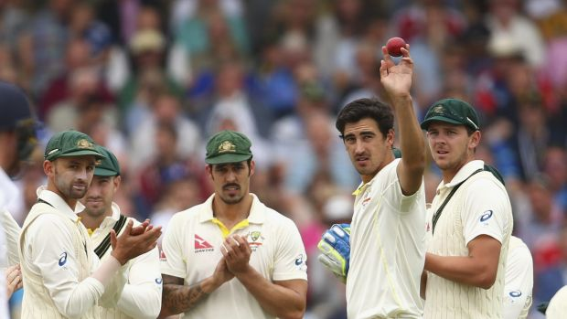 Mitchell Starc holds the ball aloft after claiming his fifth wicket on day two of the fourth Test.