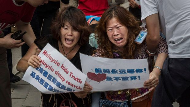 Chinese relatives of missing passengers protest at the Malaysian embassy in Beijing.