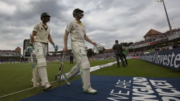 Adam Voges and Mitchell Starc leave the field after another bad day for Australia.