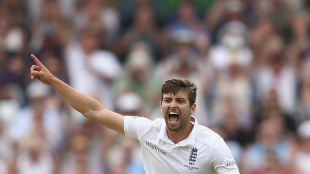 Mark Wood of England celebrates after taking the wicket of Josh Hazlewood.