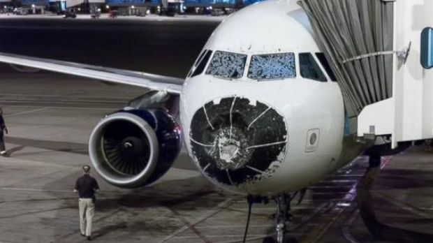 The badly damaged Delta plane after it flew through a hail storm.