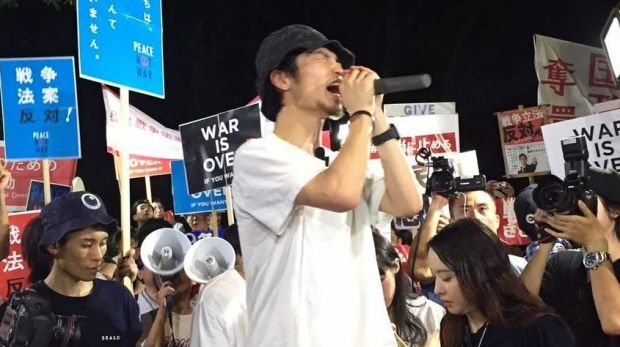 Polite  but determined: Protesters gather in Tokyo to sound off about PM Shinzo Abe's constitutional reforms.