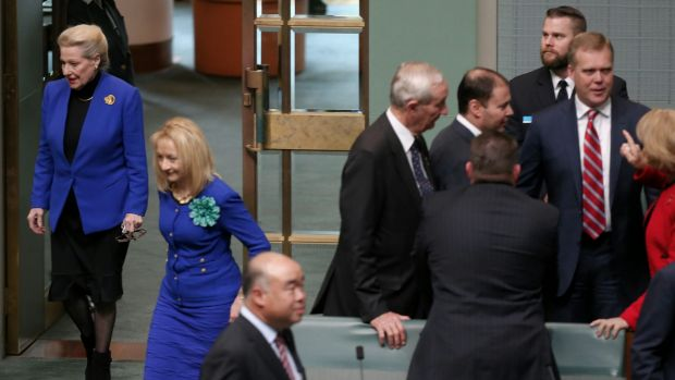 Former speaker Bronwyn Bishop enters the chamber while Tony Smith is congratulated by colleagues in the House of ...