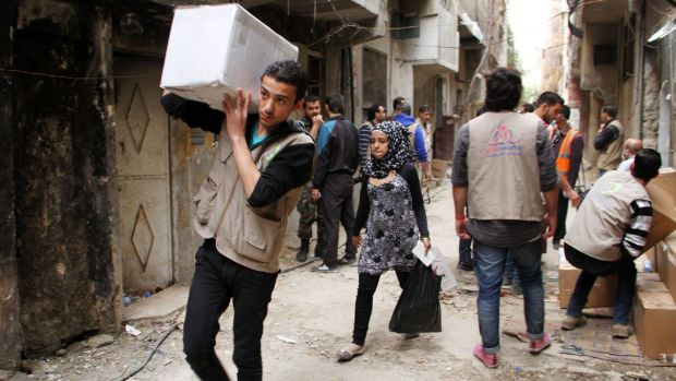 Charity staff distribute aid to the residents of the besieged Yarmouk camp in March of this year. Islamic State overran ...