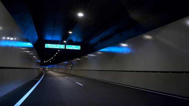 Police say an ambulance officer was assaulted in the vehicle which had been forced to stop in Brisbane's AirportLink tunnel.