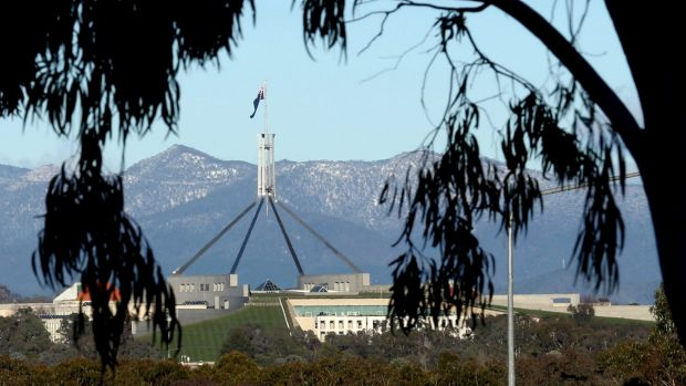 Snow settled on the Brindabellas behind Parliament House in August.