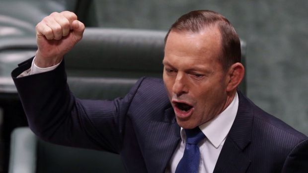 Prime Minister Tony Abbott uses his fist to emphasise a point while speaking in Parliament House.