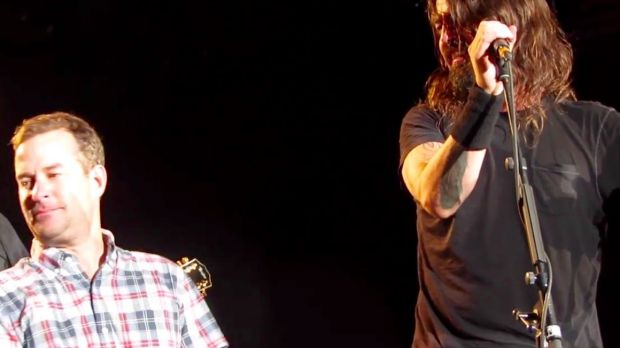 'Anthony the crying fan' is overcome and has to look away while on stage with Dave Grohl and the Foo Fighters in ...