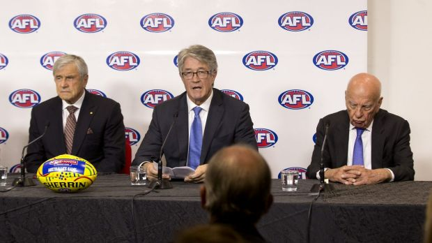 Media heavyweights Kerry Stokes and Rupert Murdoch flank AFL Commission chairman Mike Fitzpatrick at the recent ...