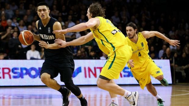 Talented: Reuben Te Rangi is challenged by Cameron Bairstow during game two between the New Zealand Tall Blacks and ...