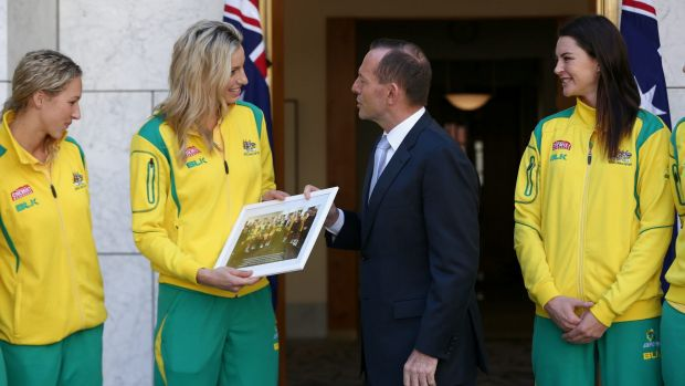 Mr Abbott poses for photos with the Australian Diamonds in the Prime Minister's courtyard.