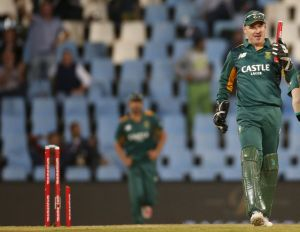 Snapped: South Africa's wicketkeeper Morne van Wyk holds a broken stump after teammate Dale Steyn took the wicket of New ...