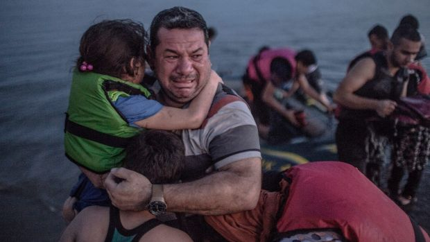 This photo of Syrian refugee Laith Majid and his children struck a chord with thousands around the world.
