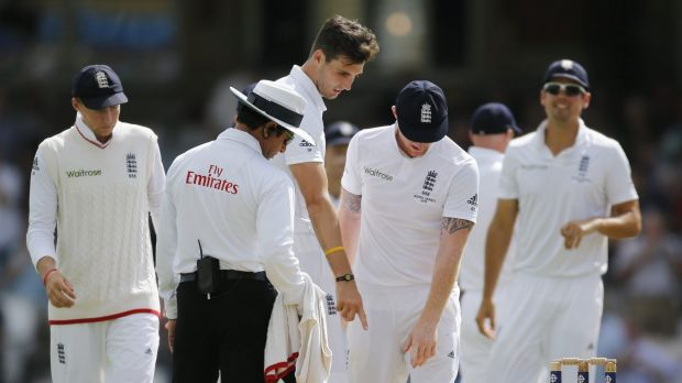 Steven Finn looks dejected after the wicket of Steve Smith is overruled.