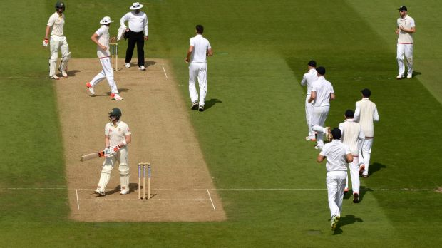 Steve Smith prepares to leave the field, but Steven Finn had bowled a no ball.