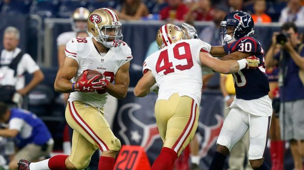 Cisco kid: Jarryd Hayne (left) rushes during a pre-season game with the San Francisco 49ers.