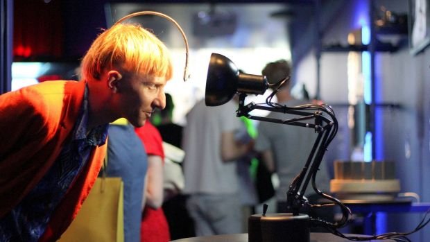 Neil Harbisson, the world's first cyborg, with Pinokio, the curious robotic desk lamp that wants to capture your attention.