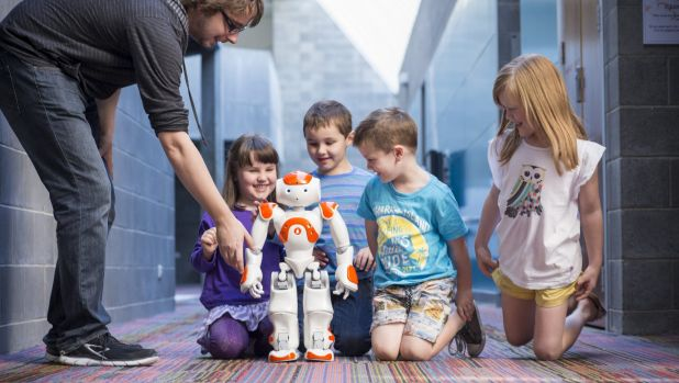 Neo Robot children for Robotronica Nao robot and children, with PhD student Gavin Suddrey.