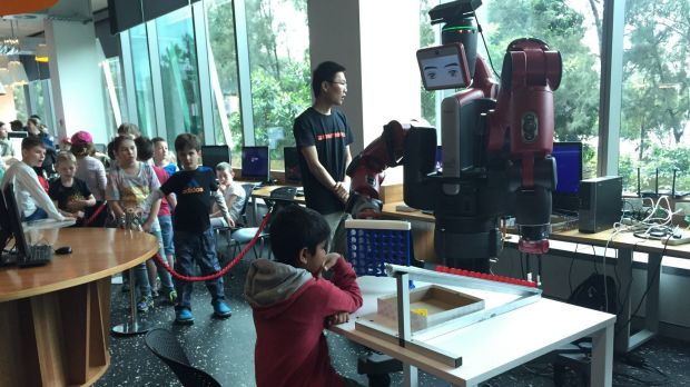 Eight-year-old Abhishek plays Connect Four with a robot named Baxter.