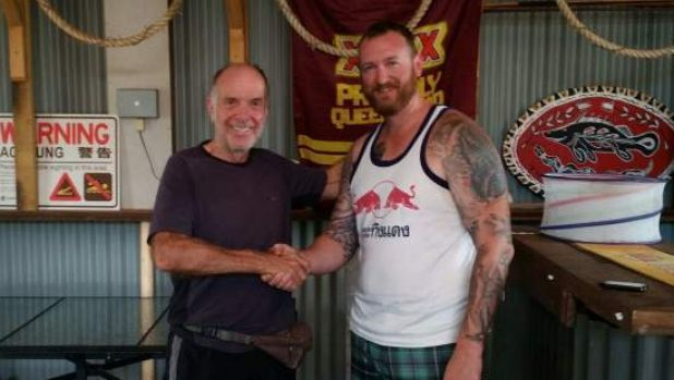 Geoff Keys thanks his rescuer, Senior Constable Brad Foat. Mr Keys was found after writing a plea for help in the sand ...