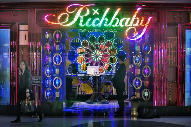 A young woman with a Louis Vuitton handback leaves 'Richbaby' a nightclub close to the Xintiandi shopping area. The club ...