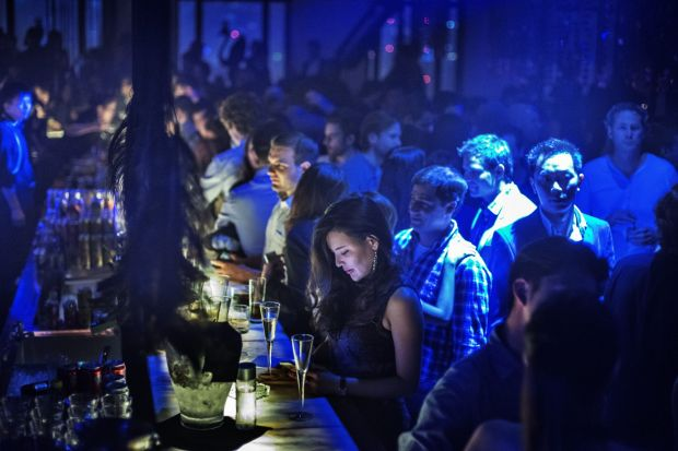 The crowded bar late at the Black Swan party at M1NT, one of Shanghai's most exclusive nightclubs. Around 2,500 guests ...