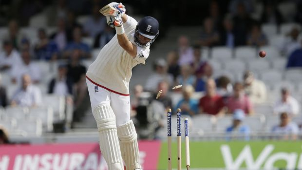 Stuart Broad is bowled by Peter Siddle.