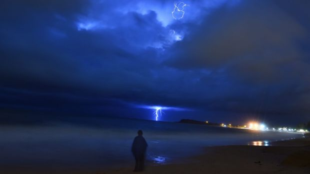 The storm moves out to sea on Monday night, as seen from Narrabeen.