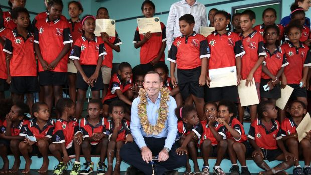 Tony Abbott joins students from Tagai State College on Mer Island.