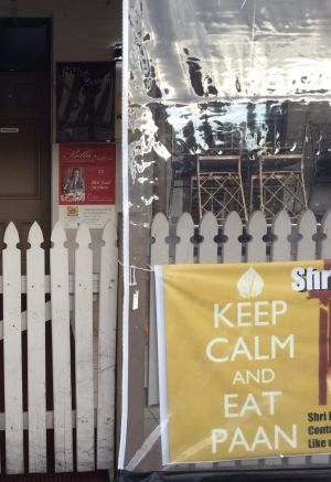 A sign at the front of the restaurant says: Keep calm and eat paan.
