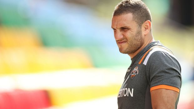 Sidelined: Robbie Farah suffered a knee injury in the Tigers' trial match against Cronulla.