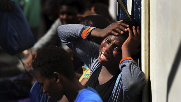Refugees continue to flood into Europe. Pictured: a woman aboard a European ship after being rescued in the Mediterranean.