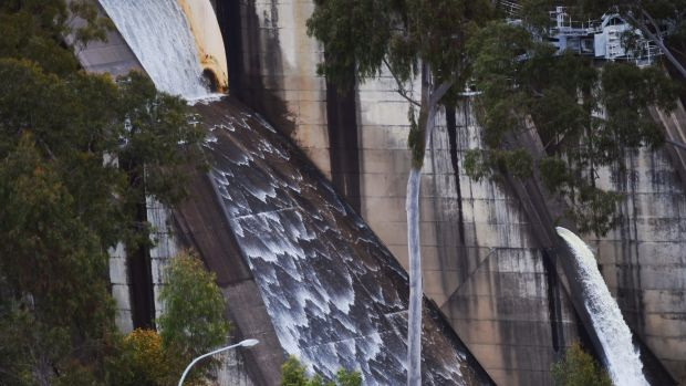 Water flows over the Warragamba Dam spillway on Thursday.