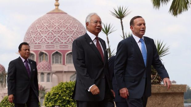 Prime Minister Tony Abbott was greeted by Malaysian Prime Minister Najib Razak in Kuala Lumpur in September last year.
