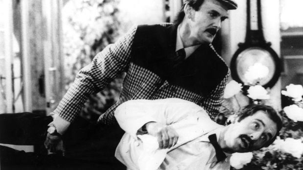 John Cleese as Basil and Andrew Sachs as Manuel in a scene from <i>Fawlty Towers</i>.