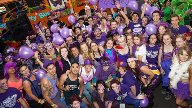 People dress up for a Wear It Purple day event.