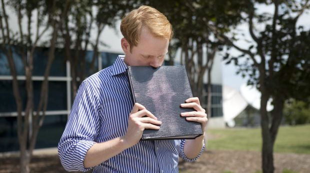 WDBJ7 news anchor Chris Hurst is overcome with emotion while holding a photo album created by his fellow reporter and ...