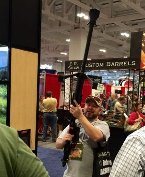 A man holds a massive gun at the annual NRA show in Nashville in April.