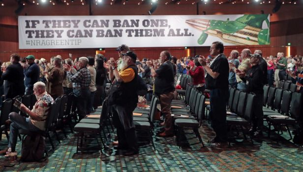 NRA members applaud a speech during their annual meeting in April.