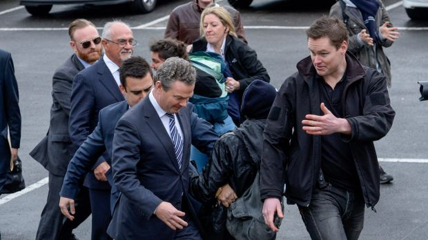 Student protesters confront Education Minister Christopher Pyne at Victoria University's Nicholson Campus in Footscray.