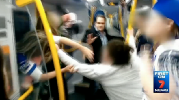 A male passenger tries to stop a brawl between teenage girls on a Sydney train.