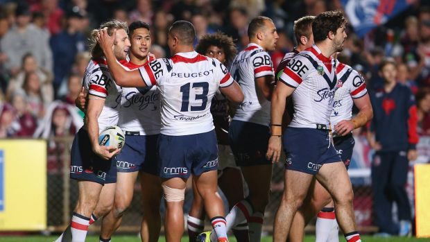Hat-trick hero: Brendan Elliot of the Roosters celebrates a try.