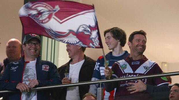 Flying the flag: Hugh Jackman shows his support for the Sea Eagles.