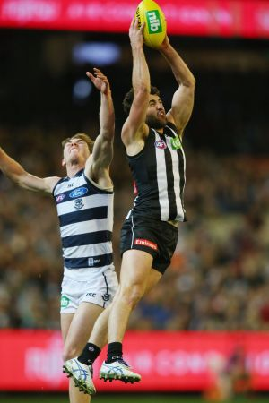 Collingwood's Alex Fasolo leaps high to mark against Geelong on Friday.