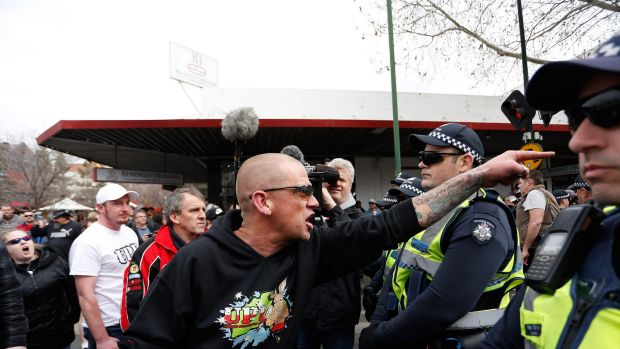 An anti-mosque protester yells over police lines at the rally.