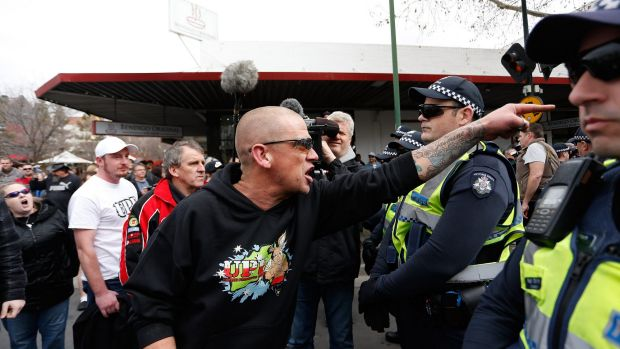 An anti-mosque protester yells over police lines at a rally in August.