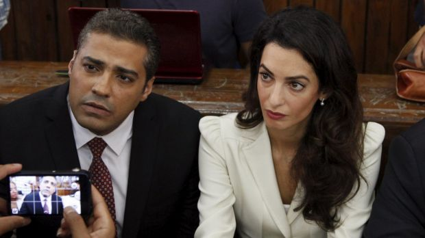 Al Jazeera television journalist Mohamed Fahmy and his lawyer Amal Clooney before hearing the verdict at a court in Cairo.