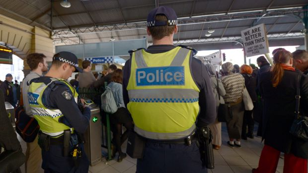 Police watch as protesters rally inside Flinders Street Station on August 28 against    Australian Border Force officers ...