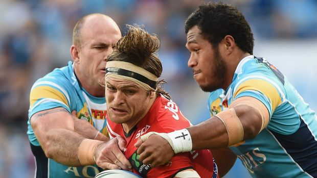 Mitch Rein of the Dragons takes on the Titans defence at Cbus Super Stadium on the Gold Coast.
